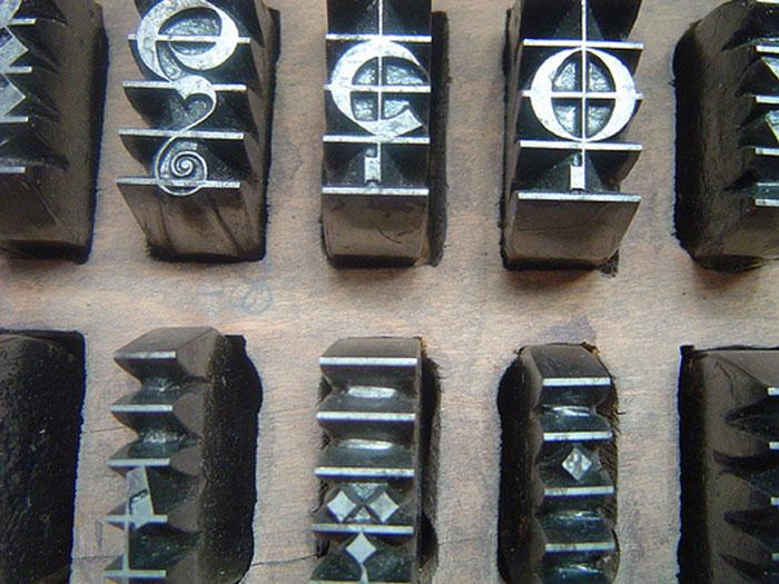 Music Printing Forme - Examples of music moveable type.